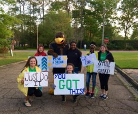Katelynn, left, and friends cheer on runners in the Rise and Shine race.